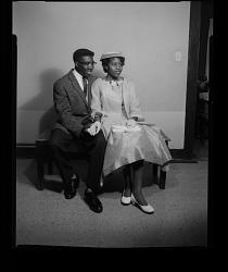 Studio Portrait of a Couple Sitting Holding Hands