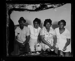 Studio Portrait of One Man and Three Women Sitting