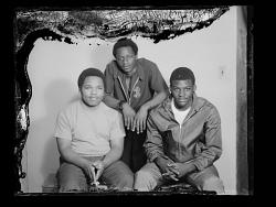 Studio Portrait of Three Boys Sitting