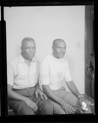 Studio Portrait of Two Men Sitting