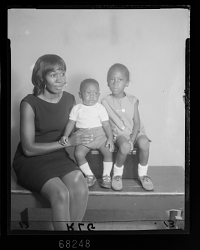 Studio Portrait of a Mother and Two Children Sitting
