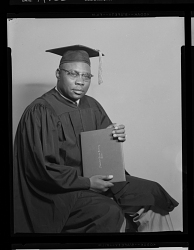 Studio Portrait of a Man Sitting Wearing Cap and Gown, Rev. Johnson