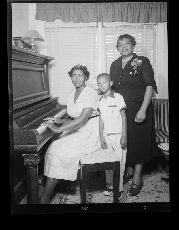 Image 1 for Indoor Portrait of Two Women and a Boy Standing at the Piano