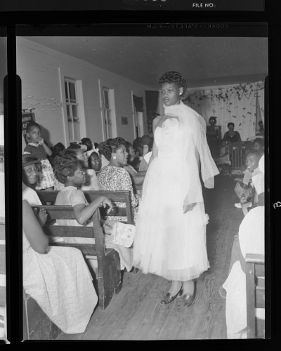Image for Indoor Portrait of a Woman Wearing a White Dress, Beautician Fashion Show