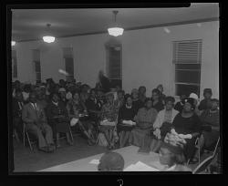 Indoor Group Shot of Men and Women Sitting