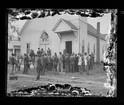 Outdoor Photo of Men Standing in front of a Church