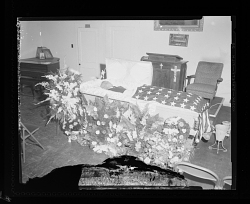 Funeral, Man Laying in an Open Casket, The American Flag is Draped over