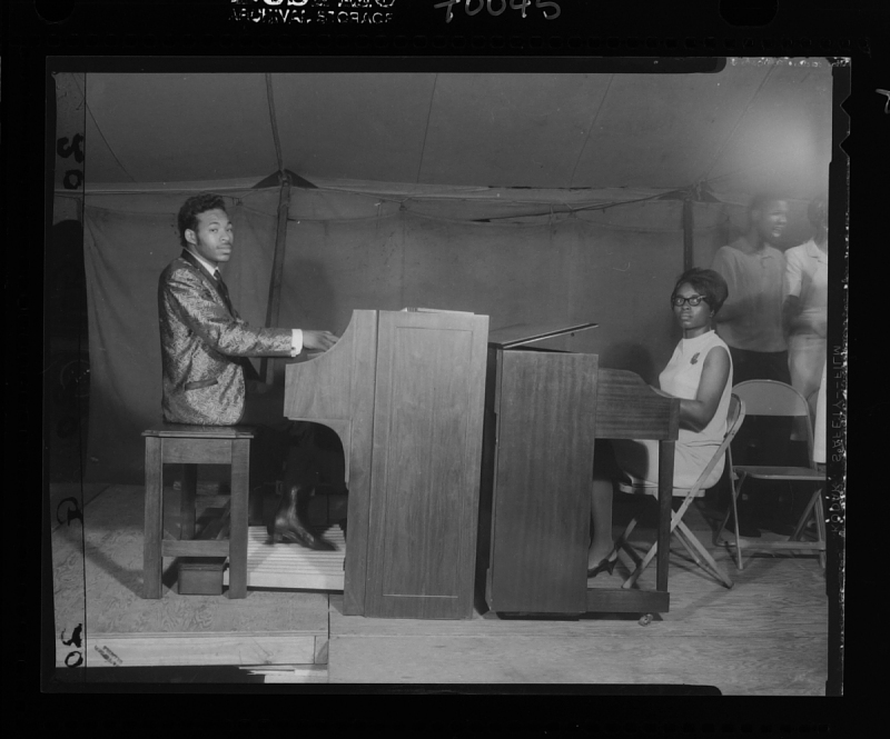 Image for Indoor Photo of a Man and Woman Facing each other and both are Playing the Piano