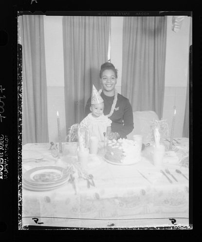Image for Indoor Portrait of A Mother and Child Sitting at a Table with a Birthday Cake