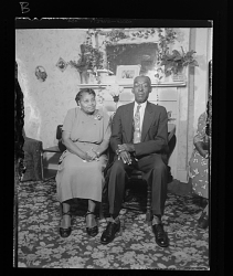 Indoor Portrait of a Couple Sitting on Chairs