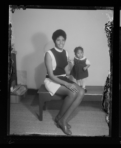 Image for Studio Portrait of a Mother Sitting and her Child is Standing Next to her