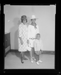 Studio Portrait of Two Woman and One Toddler Boy Standing