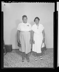 Studio Portrait of Two Women Standing