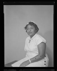 Studio Portrait of a Woman Sitting, Juanita Stark