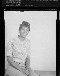 Studio Portrait of a Woman Sitting