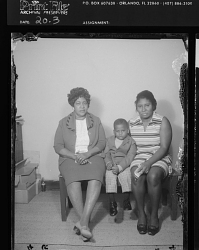 Studio Portrait of Two Women and One Toddler Boy Sitting