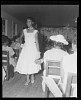 Thumbnail for Indoor Photo of a Woman Wearing a White Dress Walking