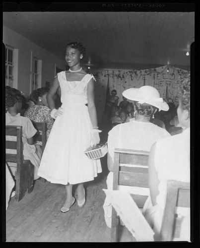 Image for Indoor Photo of a Woman Wearing a White Dress Walking
