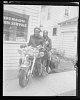 Thumbnail for Portrait of a couple on a motorcycle outside of Anderson Photo Service studio