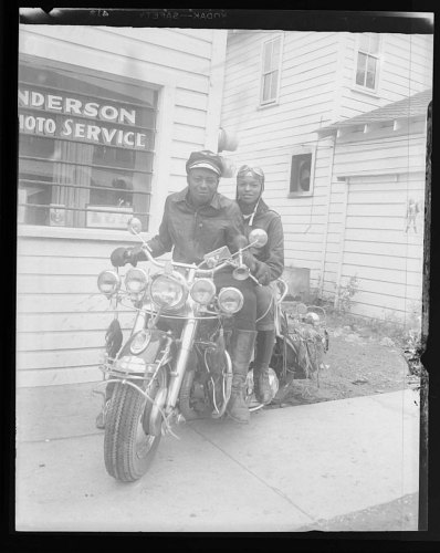 Image for Portrait of a couple on a motorcycle outside of Anderson Photo Service studio