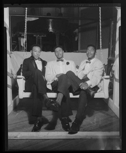 Image for Portrait of three young men sitting on a porch swing