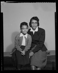 Studio Portrait of a Mother and Child Sitting