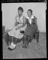 Studio Portrait of Two Girls Sitting