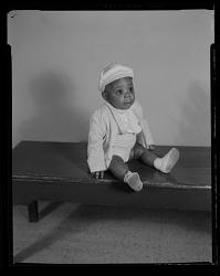 Studio Portrait of a Toddler Boy Sitting