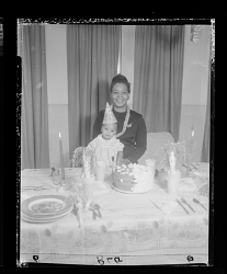 Indoor Portrait of a Mother and Child Sitting with a Birthday Cake
