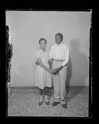 Studio Portrait of a Couple Standing Holding Hands
