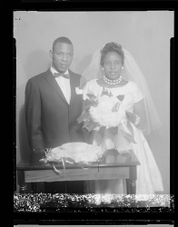 Wedding Portrait of the Bride and Groom with the Bouquet