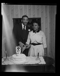 Wedding Portrait of the Bride and Groom With Wedding Cake, Parnell Diggs