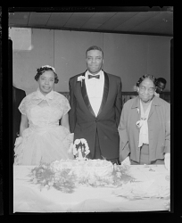 Wedding Portrait of the Bride, Groom and a Woman with the Wedding Cake