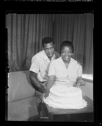 Studio Portrait of a Couple Sitting in front of a Birthday Cake
