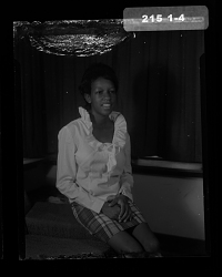 Studio Portrait of a Woman Sitting on a Sofa