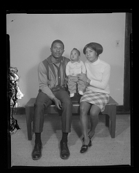 Studio Portrait of a Mother, Father and Child Sitting