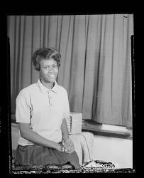 Studio Portrait of a Teenage Girl Sitting