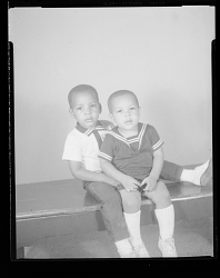 Studio Portrait of Two Toddler Boys Sitting