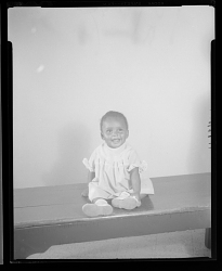 Studio Portrait of a Toddler Girl Sitting