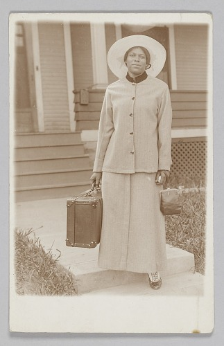 Image for Photographic postcard of unidentified woman holding a travel bag