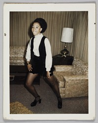 Photographic print of an unidentified woman posing in a black and white outfit
