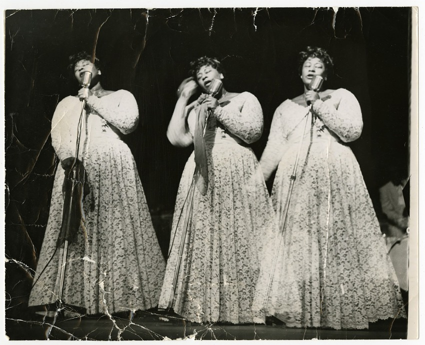 Triple-image (triple-exposure) picture of Ella Fitzgerald in concert, undated. Black-and-white photoprint.