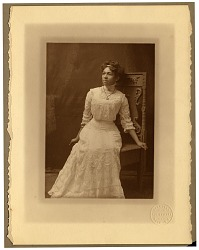 [Portrait of a young African American woman in a white dress : Black-and-white photoprint.]