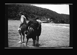 [Three African American women wading in water] [black-and-white cellulose acetate photonegative]