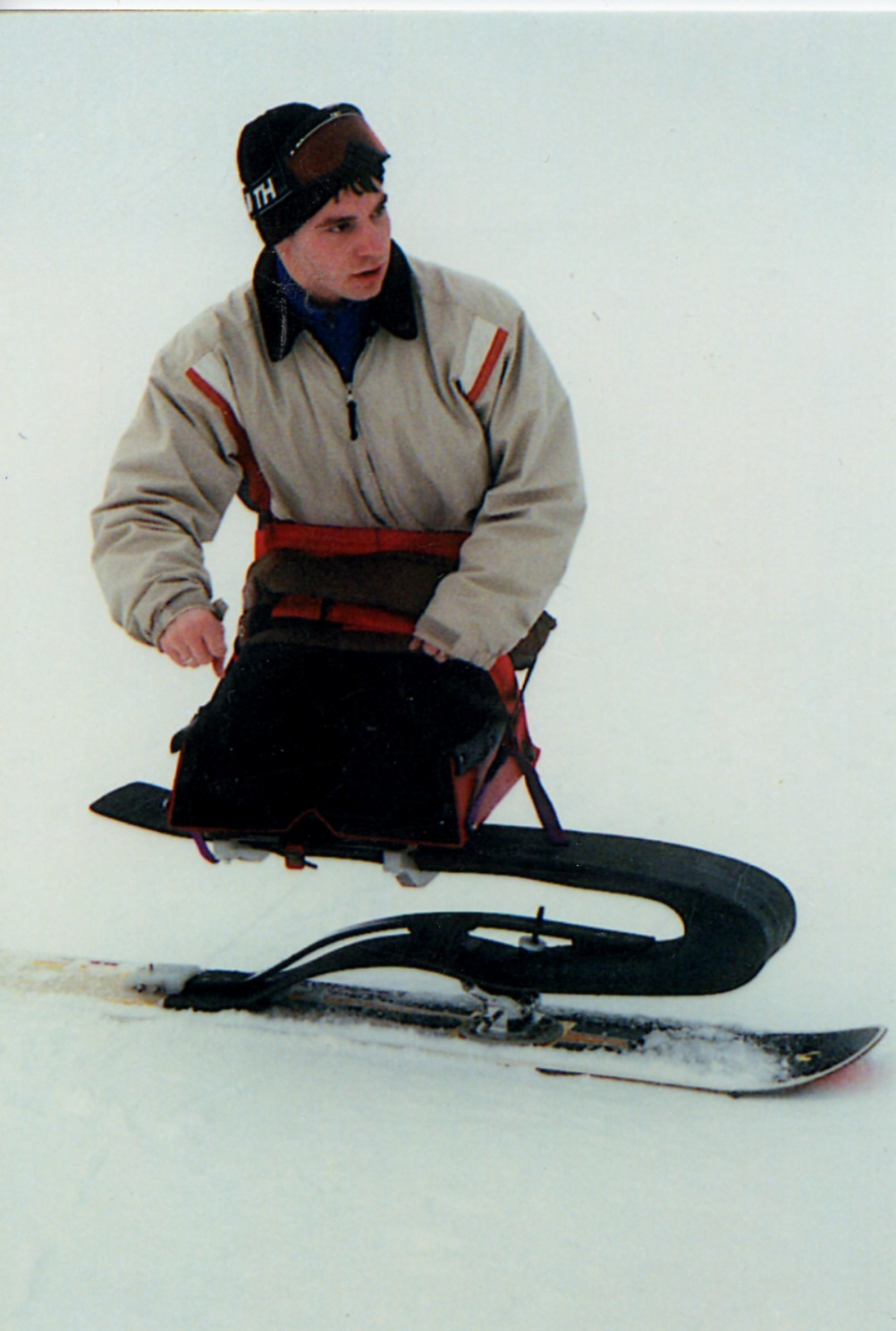 images for Unidentified young man without legs riding an accessible snowboard : color photoprint