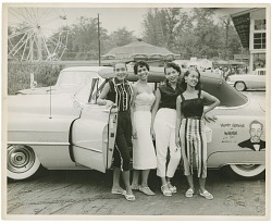 [Four young African American women standing beside a convertible automobile : black-and-white photoprint]
