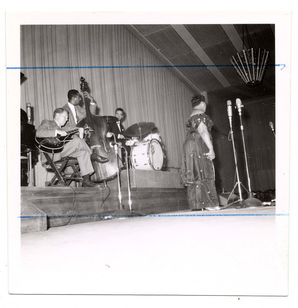 Image for Ella Fitzgerald onstage with Herb Ellis (guitar), Ray Brown (bass), Louis Bellson? (drums), undated. Black-and-white photoprint
