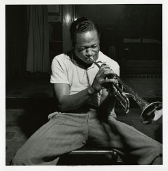"Clifford Brown at his August 28, 1053 session for ""The Clifford Brown Sextet (Blue Note) at Audio-Video Studios, New York City [black-and-white photoprint]"