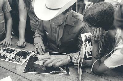 Ernest Tubb signing autographs
