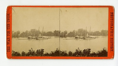 Stereograph: The monitor-class ironclad U.S.S. Canonicus, taking on coal in the James River, 1864